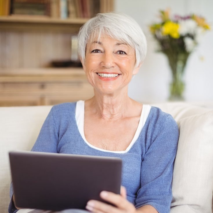 Lady On Tablet Device At Belmont Lodge - Healthcare Center